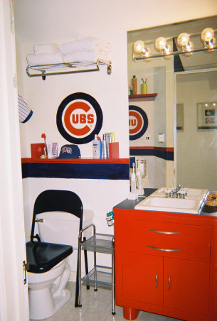 Boys Baseball bathroom , We're Cubs fans... condolences PLEASE! Once a Cubs Fan always a Cubs fan. The tradition of dying of old age waiting for a Cubs WS continues. In the interim we  turned our son's  bathroom into the Cubs locker room. Ernie Bank's locker is just across from our son's..talk abotu fantasy ball.  The mural  is complete with shoes and socks strewn so that  our son's own dirty socks on the floor won't stand out so much.   The design  was intended to visually extend what is a small bathroom.  , Boys' Rooms Design