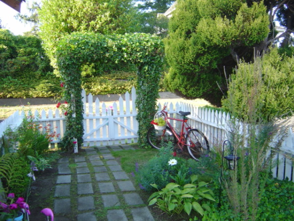 Small Cottage trellis garden, My small cottage trellis garden sideyard is finally taking shape. Hostas, roses,window boxes,garden path and water features., Red rosa climber just starting to creep up the trellis..adding another next spring., Gardens Design