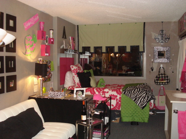 "Pink and Green/College Style, This is my daughter and her roommates' first dorm room, Freshman, so wanted it to be a space for them that was both functional and ""fun"" to live in. Biggest challenges were of course space, as with most dorm rooms, and also color. They wanted to use pink and green which can be a bit ""juvenile"" looking so also added black and a few modern twists to make it more adult .  , Room is long and narrow so mirrored desks and beds with futon in the middle.  Removed hutches off desks which made space look more open  (Note: wine bottle is mine while there for parents weekend )        , Dorm Rooms Design"