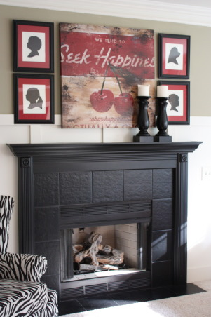 Updated Cottage Family Room, Builder grade fireplace updated with custom features.  Board and Batten style trim, artwork and black satin enamel for the mantel and ceramic tile.     , Living Rooms Design