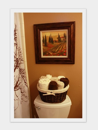 earthtone bathroom, brown and cream small bathroom  , Had to create some storage space by adding baskets.    , Bathrooms Design
