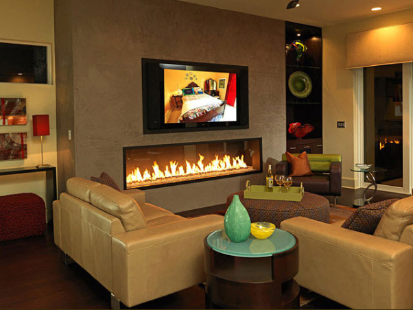 Living Room Ideas!, Here is a collection of a few living room spaces that I have recently completed. It seems that I have been working on a lot of contemporary design lately?! Please leave your comments and I will do my best to answer them., Nothing says contemporary more than a sleek polished concrete TV wall and a Montigo fireplace. This Florida living room embodies both while creating not only a modern feel but also a relaxing environment. Contemporary design characteristically does not define comfort; however it should! Your home needs to be a place that invites both you and your guest to relax in it. For this reason, I choose to use a gas fireplace and warm wood floors, which molded the warm environment with contemporary flavor.    , Living Rooms Design