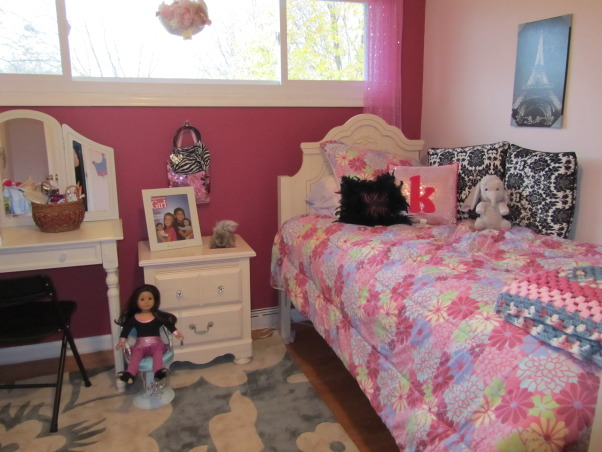 Little Diva, Tween room, girl age 9yrs. Upgraded her toddler room to this. Painted just one wall a different color - Burgundy Berry (dutch boy). She wanted a picture of Eiffel tower, so went with this., Added little girl things, can remove when she gets older. Wanted not all matchy - different patterns yet seems to go together. , Girls' Rooms Design