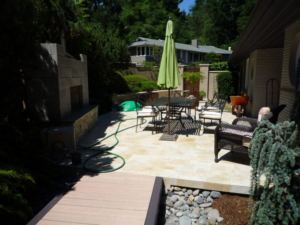 everything but the kitchen sink courtyard, Over the last year, I transformed a strip of grass and a narrow pathway in the front of my house into a beautiful courtyard with a bronze gate, tiled patios an outdoor fireplace and a Koi pond. No I don't do this for a living, but I am open to any job opportunities. HGTV are you listening?., under construction   , Outdoor Spaces