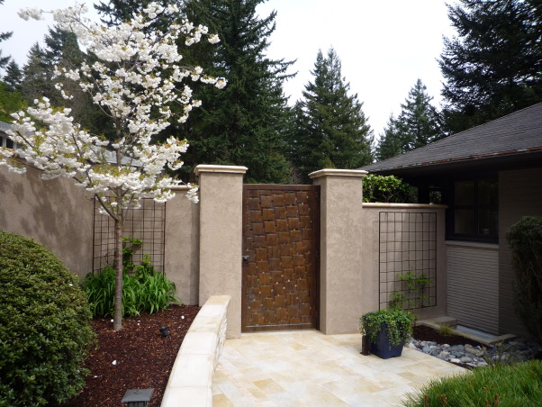 everything but the kitchen sink courtyard, Over the last year, I transformed a strip of grass and a narrow pathway in the front of my house into a beautiful courtyard with a bronze gate, tiled patios an outdoor fireplace and a Koi pond. No I don't do this for a living, but I am open to any job opportunities. HGTV are you listening?., Bronze gate    , Outdoor Spaces