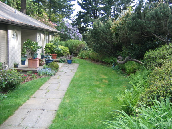 everything but the kitchen sink courtyard, Over the last year, I transformed a strip of grass and a narrow pathway in the front of my house into a beautiful courtyard with a bronze gate, tiled patios an outdoor fireplace and a Koi pond. No I don't do this for a living, but I am open to any job opportunities. HGTV are you listening?., before the courtyard this entry had little going for it. , Outdoor Spaces