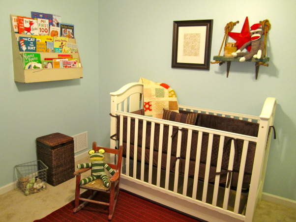 Reid's Nursery, Reid's nursery we did on a budget.  A mix of old and new with pops of red., Left side of room- The quilt I got from Etsy. The rocking chair I found in my parents attic. I already had the laundry hamper. The silver basket was a gift from my mom., Nurseries Design