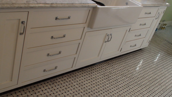 Authentic 1927 Kitchen Vintage Remodel - White White White and Black, I have always had a strong desire to create and restore since I was a little girl.  My husband and I have been restoring a historic bed and breakfast for the last 3 years and we are almost ready to open.  One of the last rooms (and most important) that we restored is our 1927 kitchen.  As a graphic designer, I designed my kitchen on computer first and it turned out exactly as planned!  Details are everything!  We wanted to keep it authentic and hide as much modern as possible, but still make it functional for today's day and age.  Everything has hydraulic pullouts, including the decorative hood around the oven.  We also used subway tile, pressed tin ceiling, basketweave marble, and a lot of glass.  This has been a labor of love...hope you enjoy the pictures!  :), The flooring is a basketweave marble, which is in the rest of the house (completely original).  The rest of the house varies in color.         , Kitchens  Design