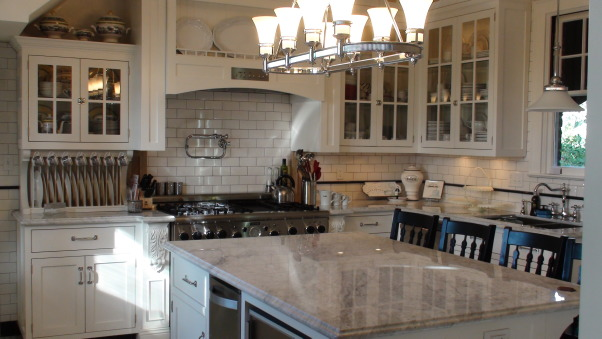 Authentic 1927 Kitchen Vintage Remodel - White White White and Black, I have always had a strong desire to create and restore since I was a little girl.  My husband and I have been restoring a historic bed and breakfast for the last 3 years and we are almost ready to open.  One of the last rooms (and most important) that we restored is our 1927 kitchen.  As a graphic designer, I designed my kitchen on computer first and it turned out exactly as planned!  Details are everything!  We wanted to keep it authentic and hide as much modern as possible, but still make it functional for today's day and age.  Everything has hydraulic pullouts, including the decorative hood around the oven.  We also used subway tile, pressed tin ceiling, basketweave marble, and a lot of glass.  This has been a labor of love...hope you enjoy the pictures!  :), The countertop is carerra marble (like the old candy stores).  There are different lighting aspects.  The main chandelier illuminates the room by light bouncing upwards and off the white tin ceiling tiles.  The upper cabinets are all transparent glass with glass shelving and are lit.  The very upper cabinets have ribbed frosted glass so that less desirable things (crockpots, books, etc) can be stored up high and accessed by built in ladder.         , Kitchens  Design