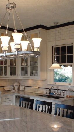 Authentic 1927 Kitchen Vintage Remodel - White White White and Black, I have always had a strong desire to create and restore since I was a little girl.  My husband and I have been restoring a historic bed and breakfast for the last 3 years and we are almost ready to open.  One of the last rooms (and most important) that we restored is our 1927 kitchen.  As a graphic designer, I designed my kitchen on computer first and it turned out exactly as planned!  Details are everything!  We wanted to keep it authentic and hide as much modern as possible, but still make it functional for today's day and age.  Everything has hydraulic pullouts, including the decorative hood around the oven.  We also used subway tile, pressed tin ceiling, basketweave marble, and a lot of glass.  This has been a labor of love...hope you enjoy the pictures!  :), Above this window will eventually have antique plates for display.         , Kitchens  Design