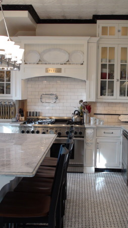 Authentic 1927 Kitchen Vintage Remodel - White White White and Black, I have always had a strong desire to create and restore since I was a little girl.  My husband and I have been restoring a historic bed and breakfast for the last 3 years and we are almost ready to open.  One of the last rooms (and most important) that we restored is our 1927 kitchen.  As a graphic designer, I designed my kitchen on computer first and it turned out exactly as planned!  Details are everything!  We wanted to keep it authentic and hide as much modern as possible, but still make it functional for today's day and age.  Everything has hydraulic pullouts, including the decorative hood around the oven.  We also used subway tile, pressed tin ceiling, basketweave marble, and a lot of glass.  This has been a labor of love...hope you enjoy the pictures!  :), The corner cabinets pull out for easy reaching         , Kitchens  Design