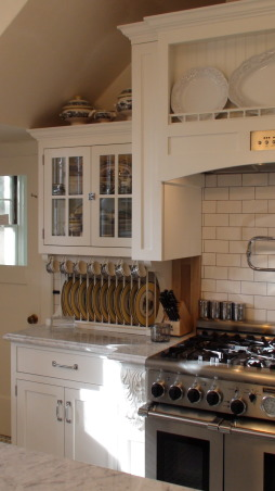 Authentic 1927 Kitchen Vintage Remodel - White White White and Black, I have always had a strong desire to create and restore since I was a little girl.  My husband and I have been restoring a historic bed and breakfast for the last 3 years and we are almost ready to open.  One of the last rooms (and most important) that we restored is our 1927 kitchen.  As a graphic designer, I designed my kitchen on computer first and it turned out exactly as planned!  Details are everything!  We wanted to keep it authentic and hide as much modern as possible, but still make it functional for today's day and age.  Everything has hydraulic pullouts, including the decorative hood around the oven.  We also used subway tile, pressed tin ceiling, basketweave marble, and a lot of glass.  This has been a labor of love...hope you enjoy the pictures!  :), The cabinet to the left of the stove is reminiscent of a built in freestanding cabinet from the 20's complete with plate rack and china hutch, but the marble is carried across the top for extra counter space.         , Kitchens  Design