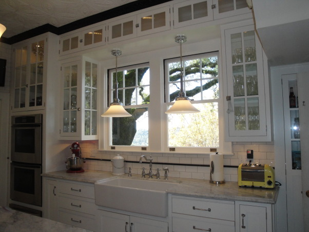Authentic 1927 Kitchen Vintage Remodel - White White White and Black, I have always had a strong desire to create and restore since I was a little girl.  My husband and I have been restoring a historic bed and breakfast for the last 3 years and we are almost ready to open.  One of the last rooms (and most important) that we restored is our 1927 kitchen.  As a graphic designer, I designed my kitchen on computer first and it turned out exactly as planned!  Details are everything!  We wanted to keep it authentic and hide as much modern as possible, but still make it functional for today's day and age.  Everything has hydraulic pullouts, including the decorative hood around the oven.  We also used subway tile, pressed tin ceiling, basketweave marble, and a lot of glass.  This has been a labor of love...hope you enjoy the pictures!  :), Kitchens  Design