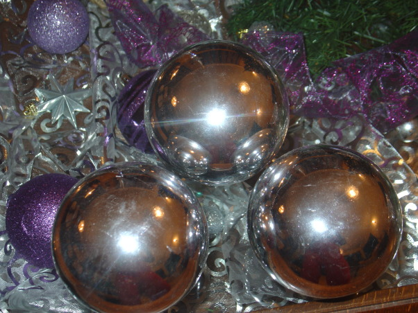 Silver and Purple Christmas, I wanted a change this Christmas but on Budget. So I decided to change just a few things on my Christmas decor, Three silver balls on top of the coffee table  , Holidays Design