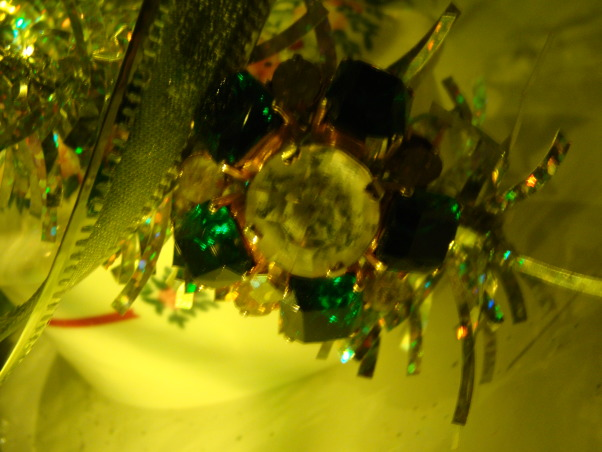 Vintage Jewelry Tree, I have used vintage jewelry to decorate a tiny tree on my bedroom mantle.  Small jewelry boxes are placed like presents at the base of the tree., Vintage broach used as decoration on my mini tree on the bedroom mantle., Holidays Design