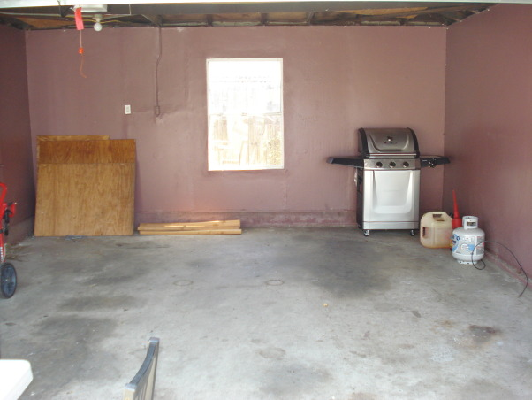 MAN CAVE / GAME ROOM, I don't mind being in the dog house, This would end up being my mancave. I epoxy floors,  framed the ceilings, added an attic, drywall on ceilings, 6 recessed lights, fresh paint, side door, and completely new electrical., Garages Design