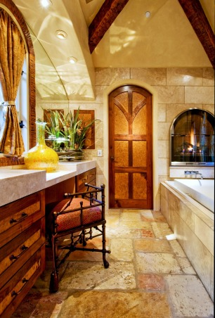 Old World Cottage Master Bathroom, Project in Carmel-by-the-Sea, California:  Jerusalem stone and travertine floors, walls and counter; gas-burning fireplace; bamboo vanity stool by John-Richards Collection; mouth-blown vase by local Carmel artist.  View more at debracampbelldesign.com., Project in Carmel-by-the-Sea, California:  Jerusalem stone and travertine floors, walls and counter; gas-burning fireplace; bamboo vanity stool by John-Richards Collection; mouth-blown vase by local Carmel artist.  View more at debracampbelldesign.com., Bathrooms Design