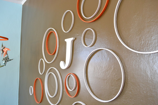 Judah's Colorful Nursery, I created a modern space for my baby boy and added lots of colors, circles, and animals with some vintage elements.  , I created this wall from embroidery hoops and stuck them to the wall with scrapbooking glue dots.  , Nurseries Design