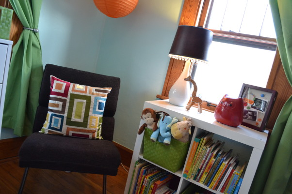 Judah's Colorful Nursery, I created a modern space for my baby boy and added lots of colors, circles, and animals with some vintage elements.  , I don't need a rocker so I got an inexpensive modern chair from Kohl's to sit in with my son.  The bookcase is from IKEA and holds toys and books.  , Nurseries Design