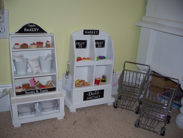 American Girl Dollhouse, My hubby and I had fun designing and making this dollhouse., Found these cute shopping carts at World Market ($7) , Girls' Rooms Design