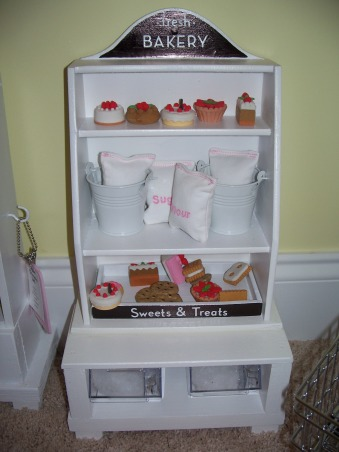 American Girl Dollhouse, My hubby and I had fun designing and making this dollhouse., The Bakery...made from a little shelf I got at the thrift store for $1.  The food is little erasers. , Girls' Rooms Design
