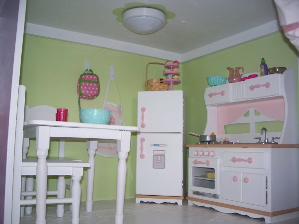 American Girl Dollhouse, My hubby and I had fun designing and making this dollhouse., The Kitchen.  The kitchen is the Our Generation Target brand.  I got the table and chairs from Tuesday Morning ($15). , Girls' Rooms Design