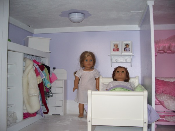 American Girl Dollhouse, My hubby and I had fun designing and making this dollhouse., Felicity and Elizabeth's room.  The bed has a trundle. My hubby and I made the closet and I sewed the bedding. The bed came from Pottery Barn. , Girls' Rooms Design
