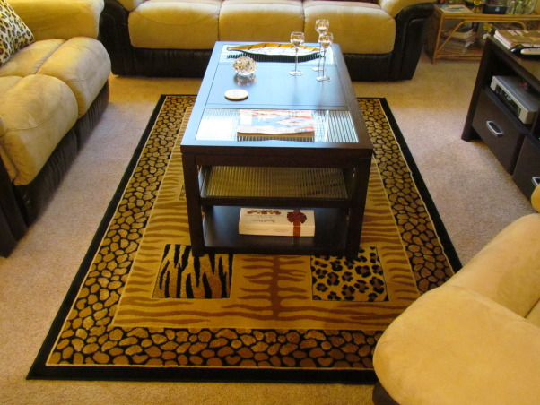 my animal print living room....  :), i looove animal prints, did my living room safari style, but tried to do it in a way i can change it when i want to at a minimum cost of jst the cusions n rugs.... :) please tell me how you like it....  :), Living Rooms Design