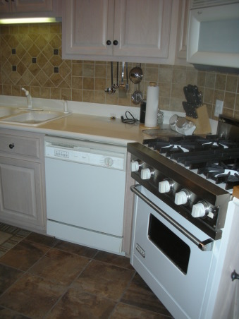 White Appliances vs Stainless Appliances, Microwave and diswasher ( as seen in this photo) and  refrig. (not seen in photo) need replacing. I will not be replacing the Viking stove (mostly white with some stainless). The cabinet tops are white Corian and the sink is white. Should I replace the diswasher, microwave, and refrig in stainless or stay with the white color?, I need to replace the dishwasher, microwave and refrig. which are white. I do not plan to replace the  Viking stove which is white with some stainless. The white Corian cabinet tops and sink will stay. Which would look the best : replace appliances with white or with stainless?, Kitchens Design