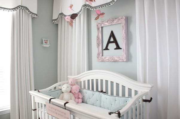 Alexis' Soft and Serene Nursery, This room was created for my newborn daughter Alexis.  I decided on a soft palette of white, robin's egg blue, and brown with pink accents.  This room is very functional, also doubling as a guest room and a place for Mommy and Daddy to be near her while she is young.  I was dealing with poor window placement, strange wall angles, and an unsightly attic door to conceal, so this room was a challenge.  The quilt and bumper were purchased from Restoration Hardware.  The draperies were custom made by yours truly!  Other bedding mixed and matched, mostly from Target.  I hope the pictures do the room justice.  I am not a photographer, but standing in the room really evokes a sense of calm, peace, and serenity.  Hope you enjoy!  , Nurseries Design