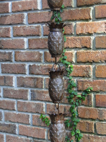 "Outdoor Therapy, I am new ""Gardeness,"" and therefore can not take credit for some of the outdoor features.  I appreciate the vision that the original home owner had. I' ve added my own touches and am enjoying my new found therapy., A Pineapple rain chain welcomes all my  guests.         , Gardens Design"
