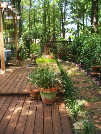 "Outdoor Therapy, I am new ""Gardeness,"" and therefore can not take credit for some of the outdoor features.  I appreciate the vision that the original home owner had. I' ve added my own touches and am enjoying my new found therapy., Walkway front to back.    , Gardens Design"
