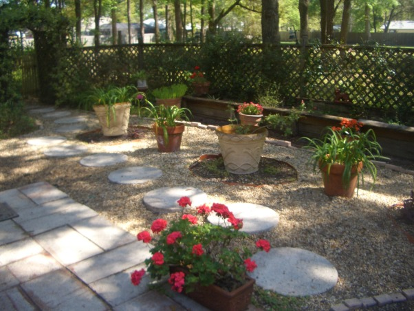 "Outdoor Therapy, I am new ""Gardeness,"" and therefore can not take credit for some of the outdoor features.  I appreciate the vision that the original home owner had. I' ve added my own touches and am enjoying my new found therapy., The rock garden was here when we moved in and while I appreciated it, it was not practical for our family.  We like the outdoors so we built a deck.  Now we get a lot more use of the space.         , Gardens Design"