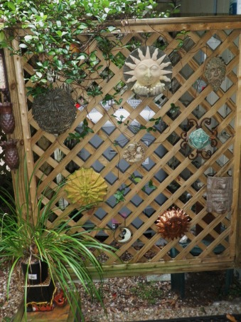 "Outdoor Therapy, I am new ""Gardeness,"" and therefore can not take credit for some of the outdoor features.  I appreciate the vision that the original home owner had. I' ve added my own touches and am enjoying my new found therapy.,  ""The Face Wall.""  When the jasmine grows in, it will hide the ac unit.     , Gardens Design"