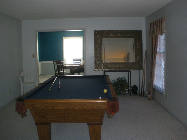 Game Room, poker room,, Poker and pool table rooms before and after. , We still need a light above the table and I want the mirror on the left wall but monted some how. He wants a UNC Tarheel light with tiffany stained glass, and I am a duke fan. So there is still no light.   , Boys' Rooms Design