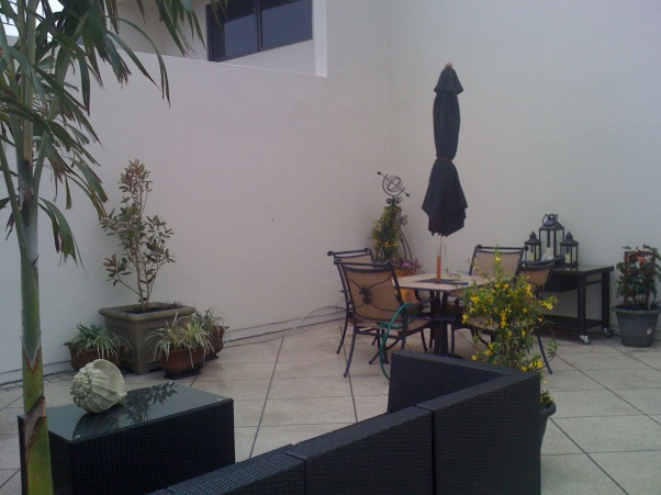 My rooftop terrace in Tampa, we have a condo with a 100 sq ft roof terrace in Tampa, Florida that we purchased 4 years ago.  It had a 500 sq foot fountain which we had to remove per the association.  left with a open space we went about floor covering.  there are no permanent structures allowed so we were limited in what we could do.  thru searching the internet and utilizing some of the discount home stores in the area this is what resulted.  we had to get everything to the 20th floor then up a 13 stair staircase to get it all outside.  we did it all ourselves no professional help!, Patios & Decks Design
