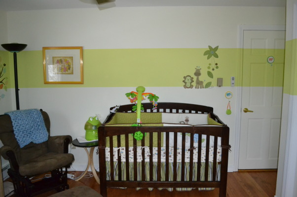 Modern jungle theme, With modern colors and a traditional theme, I tried to create a peaceful space for my newborn son., Here you see the stipe around the room and the jungle theme baby bedding,  Also, there are decals on the wall within the stripe., Nurseries Design