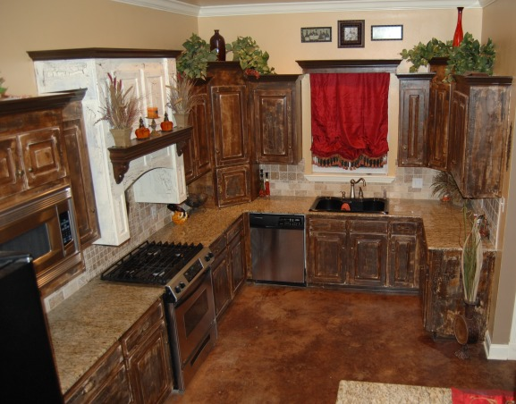 Warm and Traditional, Weathered Cabinets with granite countertops, Weathered Cabinets trimmed in chocolate.  This gives a new set of cabinets an old look.  , Kitchens Design
