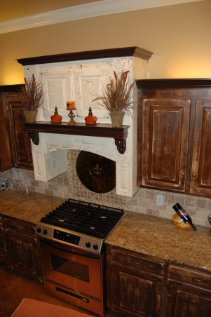 Warm and Traditional, Weathered Cabinets with granite countertops, Our mantle hood is weathered the opposite of the rest of the cabinets.  It adds the wow factor needed in the kitchen., Kitchens Design