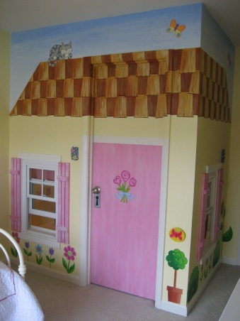 Little girl's bedroom with walk in closet/playhouse, A dream bedroom for little girls. Pink and green flowers, polka dots, and plaid fabrics.  Shutters and awning window treatment. Large closet with room to play dolls and cafe.  Cottage mural painted on wall adorned with flowers, a pet, real windows, phone and doorbell.  Furniture and bedding from Bombay Kids.  White iron daybed. This bedroom is a playroom and bedroom all in one., Girls' Rooms Design