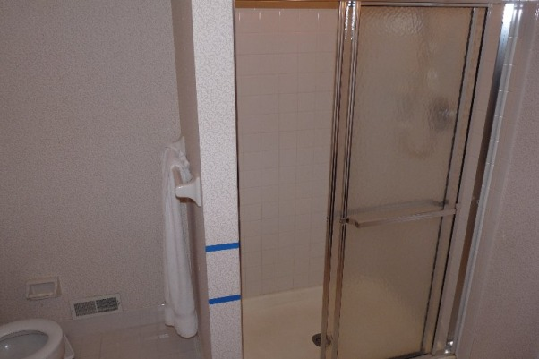 Master Bath, Master Bath remodel, standard builders shower.  We enlarged this and added a knee wall for a more open feel.  The toilet was turned to accomodate this., Bathrooms