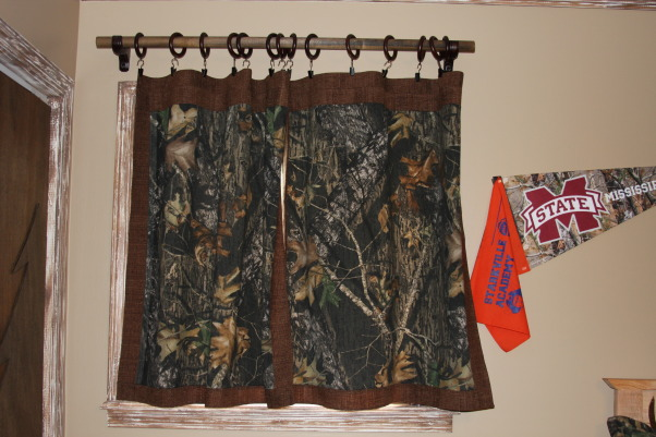 "A Hunter's Haven, I designed a ""hunter's haven"" for by 14 year old son's bedroom.  We are very outdoors-y and he loves to hunt. I used lots of Mossy Oak Break Up Pattern camo fabric and original designs using wood and other materials., This is the other Mossy Oak Break Up pattern curtain.     , Boys' Rooms Design"