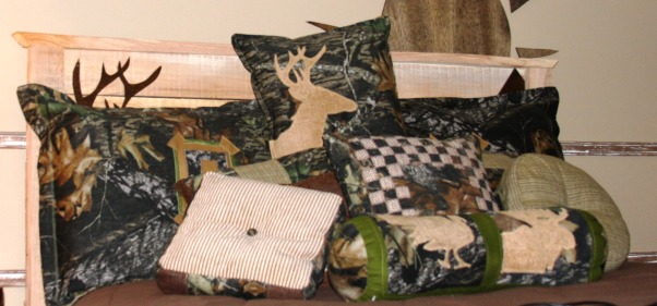 "A Hunter's Haven, I designed a ""hunter's haven"" for by 14 year old son's bedroom.  We are very outdoors-y and he loves to hunt. I used lots of Mossy Oak Break Up Pattern camo fabric and original designs using wood and other materials., I made all these pillows for his bed., Boys' Rooms Design"