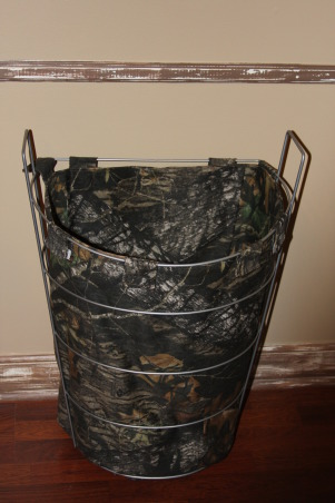 "A Hunter's Haven, I designed a ""hunter's haven"" for by 14 year old son's bedroom.  We are very outdoors-y and he loves to hunt. I used lots of Mossy Oak Break Up Pattern camo fabric and original designs using wood and other materials., This is his clothes hamper - of course in Mossy Oak Break Up pattern fabric.      , Boys' Rooms Design"