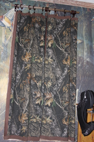 "A Hunter's Haven, I designed a ""hunter's haven"" for by 14 year old son's bedroom.  We are very outdoors-y and he loves to hunt. I used lots of Mossy Oak Break Up Pattern camo fabric and original designs using wood and other materials., He has two curtains made from Mossy Oak Break Up pattern fabric. I stained a wooden dowel for the rod and used the wooden rings from Lowes.      , Boys' Rooms Design"