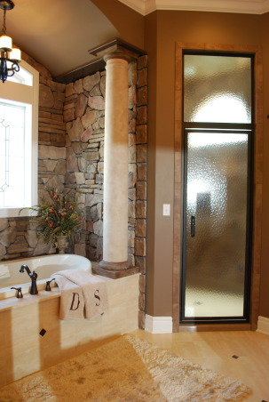 Bathroom remodel/addition, Master bathroom created to create a relaxing functional space., Stone and columns were added around the tub with barrel ceilings to create a cozy soaking area.      , Bathrooms Design