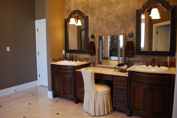 Bathroom remodel/addition, Master bathroom created to create a relaxing functional space., Master vanity area.  Instead of one large mirror added two mirrors with a vanity mirror in the middle.  Ceilings are high and casted shadows so had holes cut in mirrors and hung wall sconces upside down to create the perfect amount of light in the area.  Walls were textured and glazed to create interest to the large area.      , Bathrooms Design