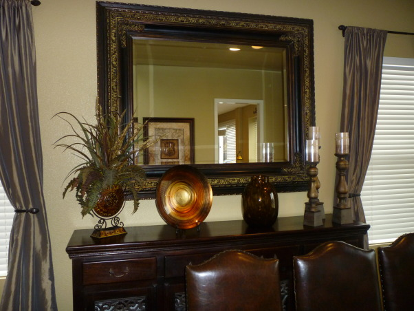 "Rustic ""Formal"" Dining, Our dining room holds our rustic furniture, my favorite piece being the iron and mahogony wood buffet. We plan on replacing the carpet with handscraped hardwood floors!, Dining Rooms Design"