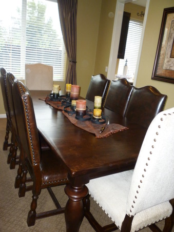 "Rustic ""Formal"" Dining, Our dining room holds our rustic furniture, my favorite piece being the iron and mahogony wood buffet. We plan on replacing the carpet with handscraped hardwood floors!, The centerpiece was bought at a boutique in Mexico handmade my a local iron worker. , Dining Rooms Design"