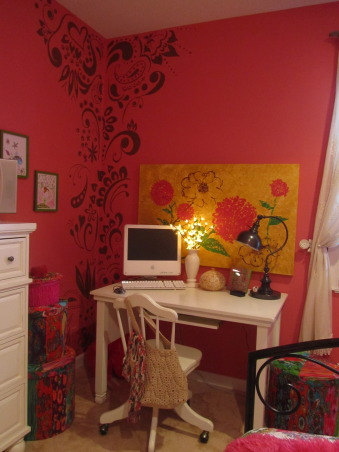 "Watermelon Room, We recently revamped my youngest's bedroom.  We decided on ""Watermelon"" as the paint color.  Both of my daughter's helped with the hand-painted Mehndi Indian artwork on the walls.  I think I have stated in other posts that my oldest daughter started this trend in our house with Mehndi Indian Bridal Tatooing that we paint on the walls. Lauren wanted her room to look like her big sister's room.  The gallery wall of art is all my own work.  I drew them with Sepia Ink Pens.  Used henna-brown colored pencils to match the Mehndi art which is normally tatooed with henna.  We decoupaged two of the frames and the ""L"" for interest.  The wall behind the bed is a chalk board wall so my daughter can be creative.    Thanks for looking., Hand-painted Mehndi we painted in the corner.  All three of us worked on this together.  I painted the pic above the desk; as mentioned it was inspired by the Kantha quilt on the bed.  A little side note to mention is that the scarf tied to the bag on the chair is the same that we used to make the neck roll pillow cover out of.  A great Walmart find and I want to borrow it because it is really pretty.                     , Girls' Rooms Design"